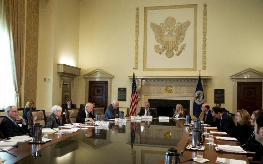Federal Reserve Chair Janet Yellen, left, presides over a meeting of the Fed board of governors in Washington.