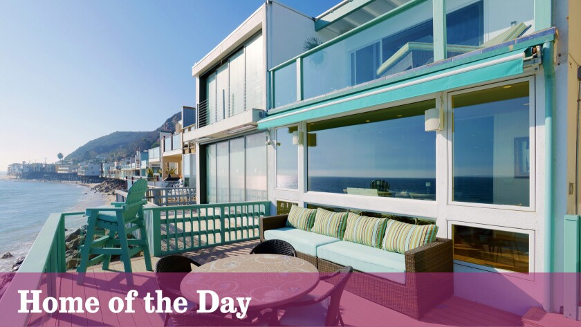 A quintessential Malibu beach house is listed at $2.47 million.
