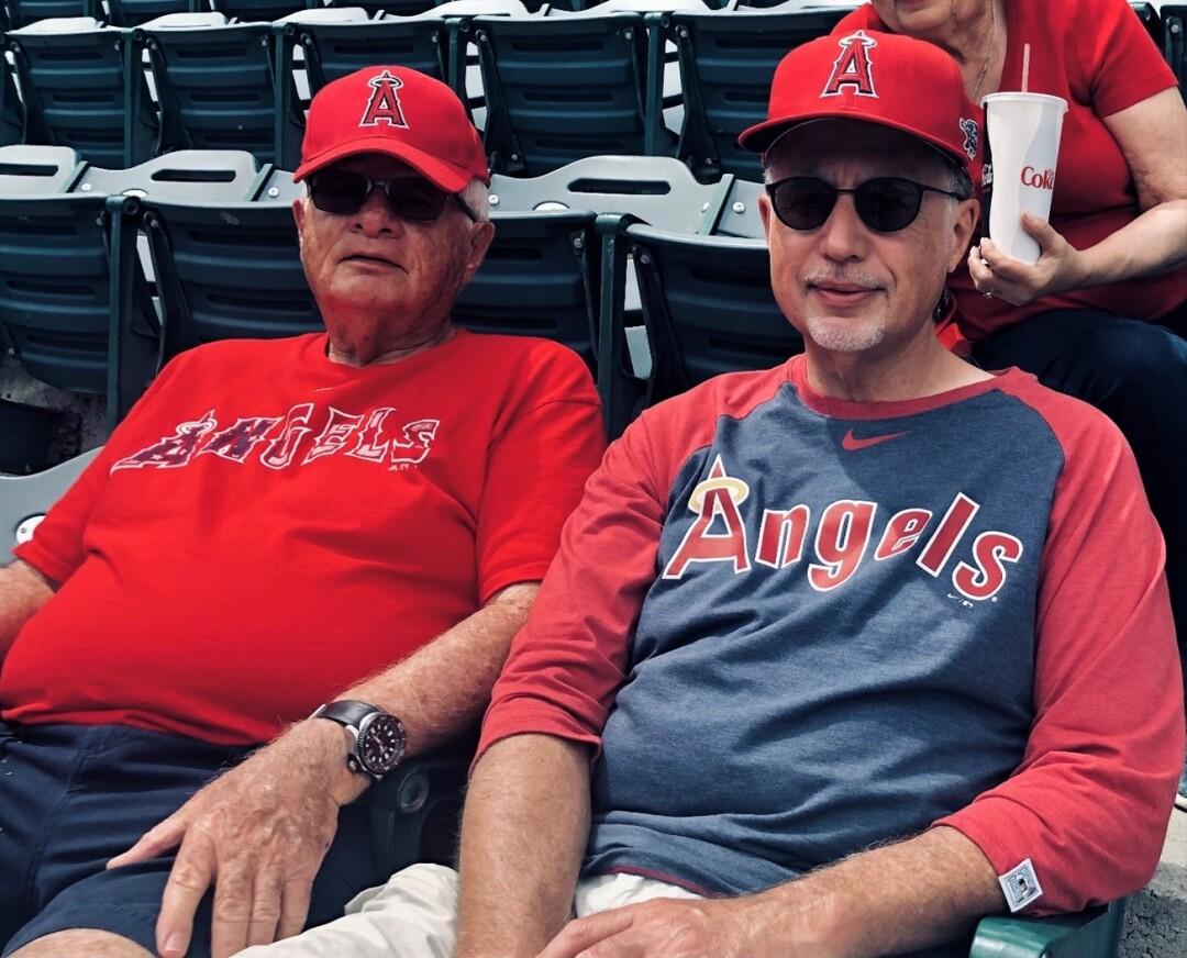 Hal Hyman, left, and son Bradley enjoy an Angels game together.