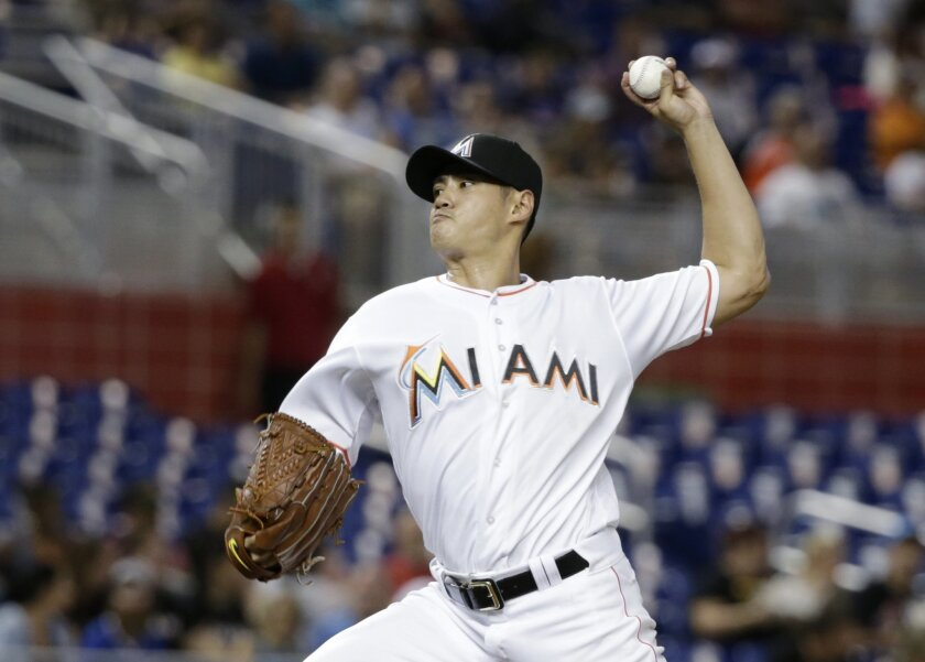 Miami Marlins' Wei-Yin Chen, of Taiwan, delivers a pitch during the first inning of a baseball game against the Pittsburgh Pirates, Thursday, June 2, 2016, in Miami. (AP Photo/Wilfredo Lee)