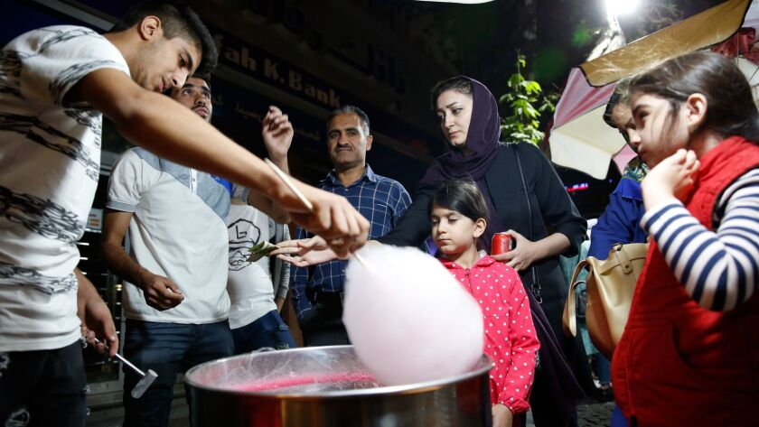 People queue to buy cotton candy at a street food market in Tehran, Iran on Oct. 11.