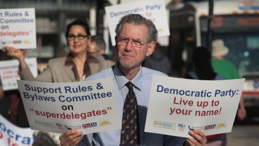 Demonstrators protest outside the Hyatt Hotel where the Democratic National Committee was were meeting in Chicago.