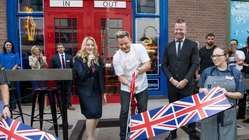 Gordon Ramsay cuts a Union Jack-decorated ribbon in the Oct. 7 opening of his newest eatery at the Linq Promenade on the Las Vegas Strip.