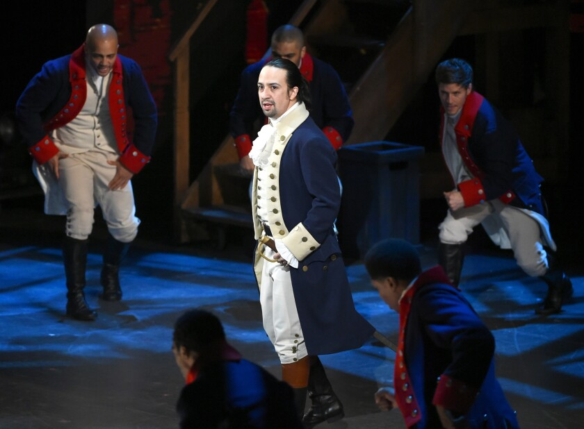 """FILE - In this June 12, 2016 file photo, Lin-Manuel Miranda and the cast of """"Hamilton"""" perform at the Tony Awards in New York. A filmed version of the original Broadway production will be available Friday, July 3, on Disney Plus. (Photo by Evan Agostini/Invision/AP, File)"""