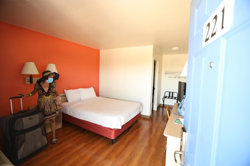 Genia Hope in her room on July 7 at a Whittier hotel that was part of Project Roomkey.