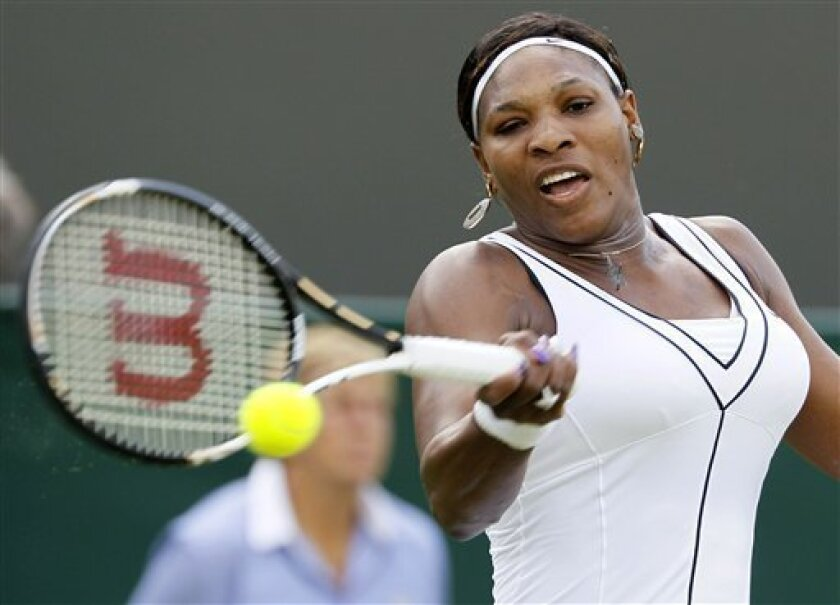 Serena Williams of the US returns a shot to Romania's Simona Halep during their match at the All England Lawn Tennis Championships at Wimbledon, Thursday, June 23, 2011. (AP Photo/Alastair Grant)