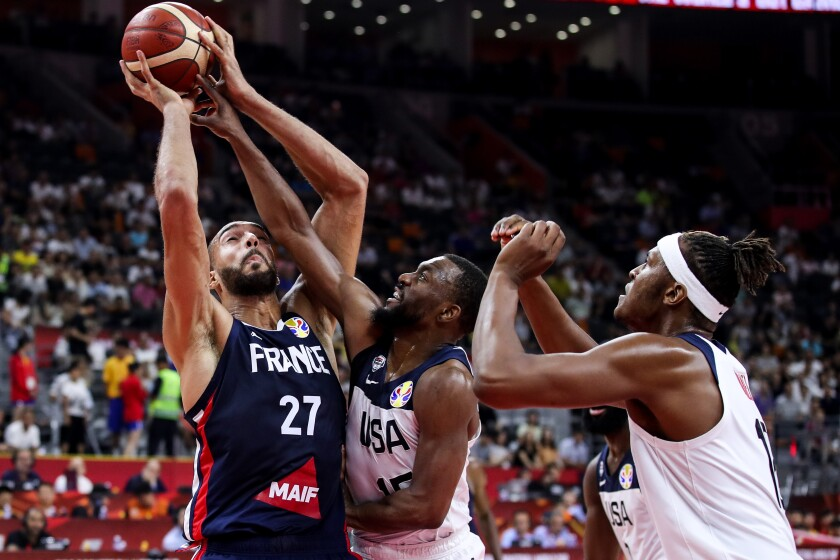 Evan Fournier of France drives as Kemba Walker of Team USA defends during a FIBA World Cup game Sept. 11 in Dongguan, China.