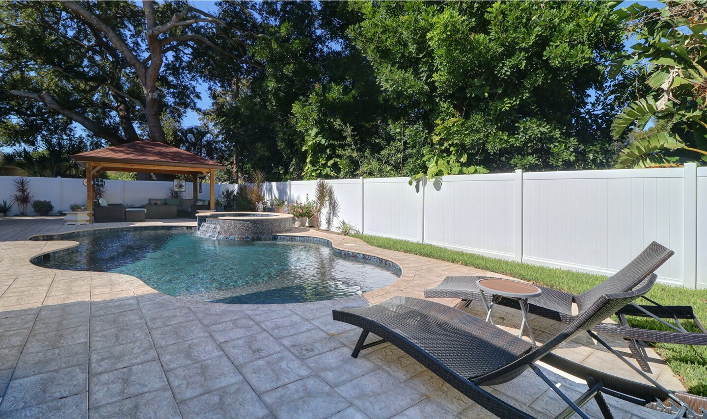 Recently remodeled, the single-story home expands to a fenced backyard with a pool, spa and gazebo.