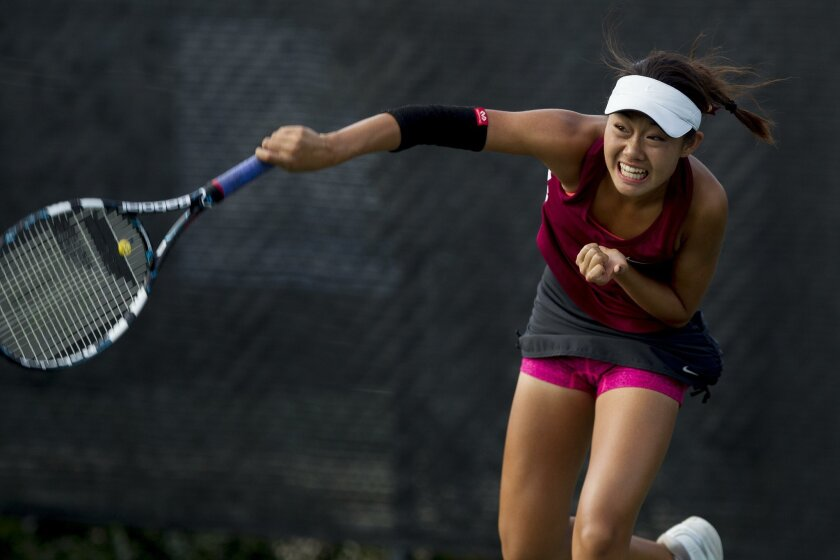Torrey Pines freshman Hannah Zhao delivers a shot in the San Diego Section Open Division final against La Jolla Country Day. Zhao swept her three singles sets as the Falcons won their 25th straight section title.