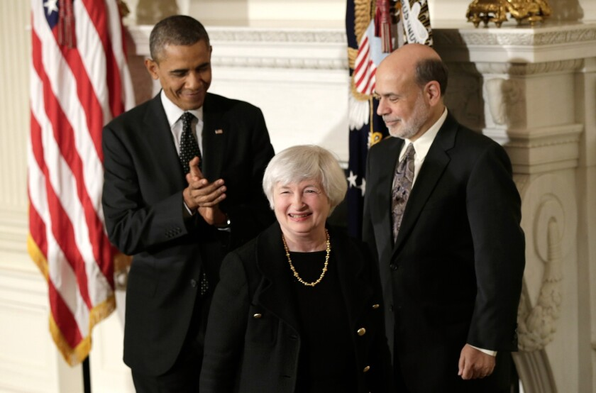 Janet L. Yellen smiles as President Obama and Ben Bernanke applaud her during a news conference to announce her nomination to chair the Federal Reserve in 2013.