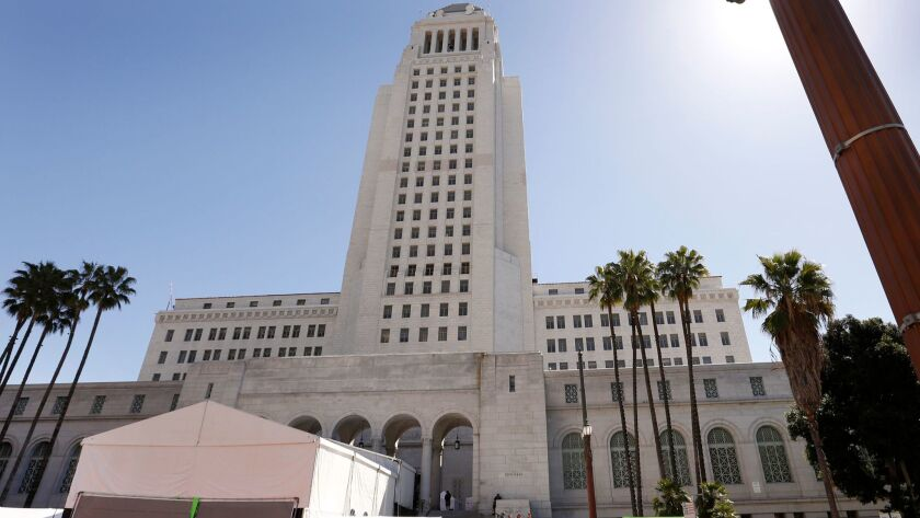The city will pay $4.5 million to the family of a cyclist who was killed in Eagle Rock after he hit a rough patch of pavement on Colorado Boulevard and flipped three times. Above, Los Angeles City Hall.