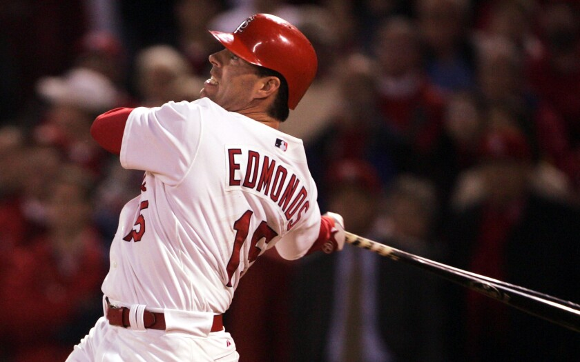 Jim Edmonds hits a home run with the St. Louis Cardinals in 2004.