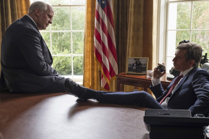 "Christian Bale, left, as Dick Cheney and Sam Rockwell as George W. Bush in a scene from Adam McKay's ""Vice."""