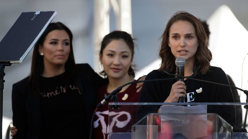 Actress Natalie Portman, right, opens the 2018 Women's March in Los Angeles with Eva Longoria, left, and Constance Wu.