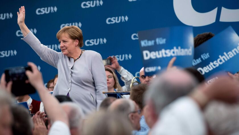 German Chancellor Angela Merkel waves after giving a speech during an election campaign event in a b