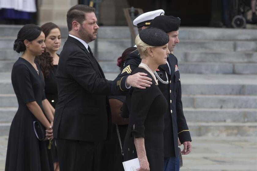 Widow of John McCain, Cindy McCain (Front R) and family members watch a US military honor guard team carry the flag-draped casket of John McCain out of the Washington National Cathedral at the end of a memorial service in Washington, DC, USA, 01 September 2018. EFE/EPA