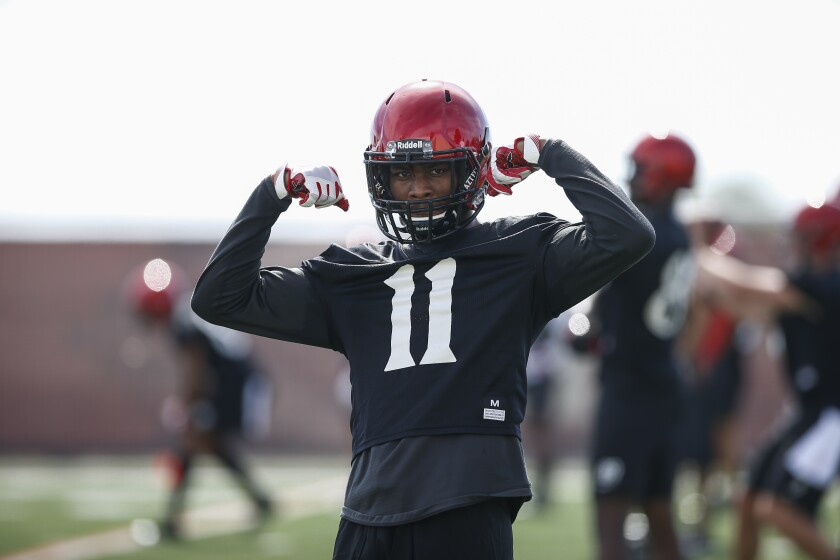 Freshman athlete Brionne Penny strikes a pose during San Diego State's opening football practice last week.