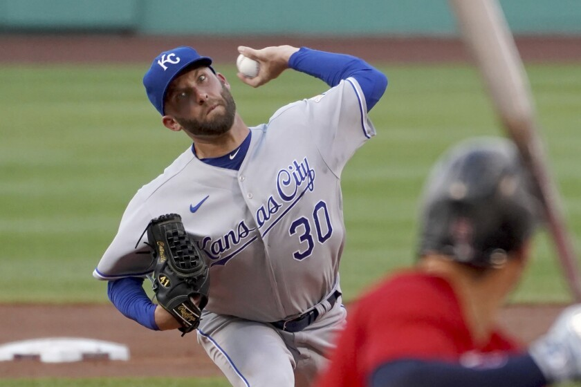 In Kansas City Royals uniform, Danny Duffy throws a pitch.