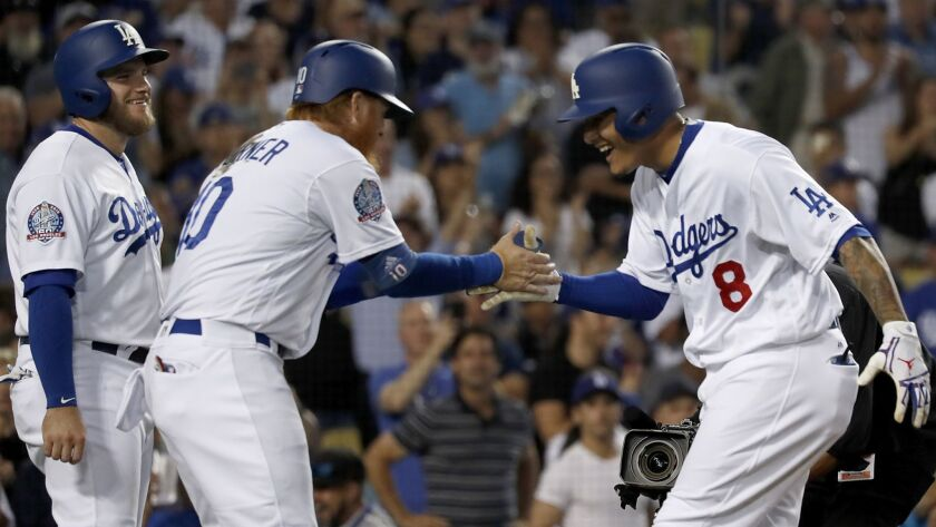 LOS ANGELES, CALIF. - SEP. 22, 2018. Dodgers shortstop Manny Machado, right, is congratulated by te