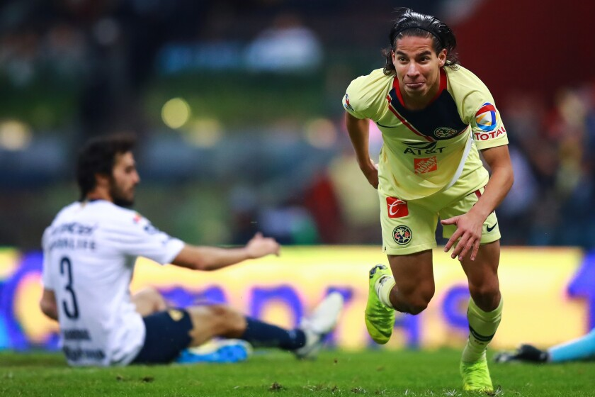 Diego Lainez #20 of America celebrates after scoring the 5th goal of his team during the semifinal second leg match between America and Pumas UNAM as part of the Torneo Apertura 2018 Liga MX at Azteca Stadium on December 9, 2018 in Mexico City, Mexico.