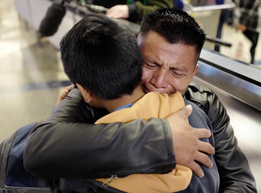 David Xol-Cholom, of Guatemala, reunites with his son Byron at Los Angeles International Airport on Jan. 22, 2020.