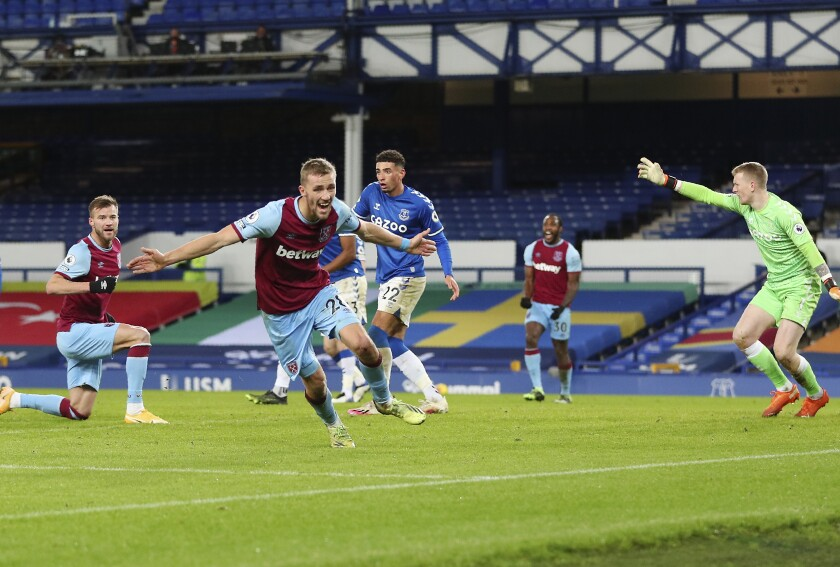 West Ham's Tomas Soucek celebrates after scoring his side's opening goal during the English Premier League soccer match between Everton and West Ham at Goodison Park in Liverpool, England, Friday, Jan. 1, 2021. (Peter Byrne,Pool via AP)
