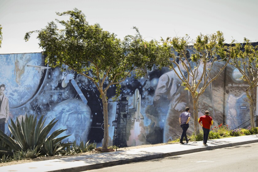 """The Spirit of Aerospace"" mural, created by Scott Bloomfield and sponsored by Hughes Electronics Corp. and the South Bay Masonic Lodge, adorns a portion of Main Street."