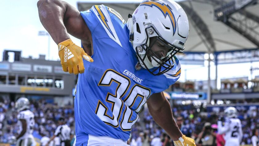 CARSON, CA, SIUNDAY, OCTOBER 7, 2018 - Chargers running back Austin Ekeler dances in the end zone af