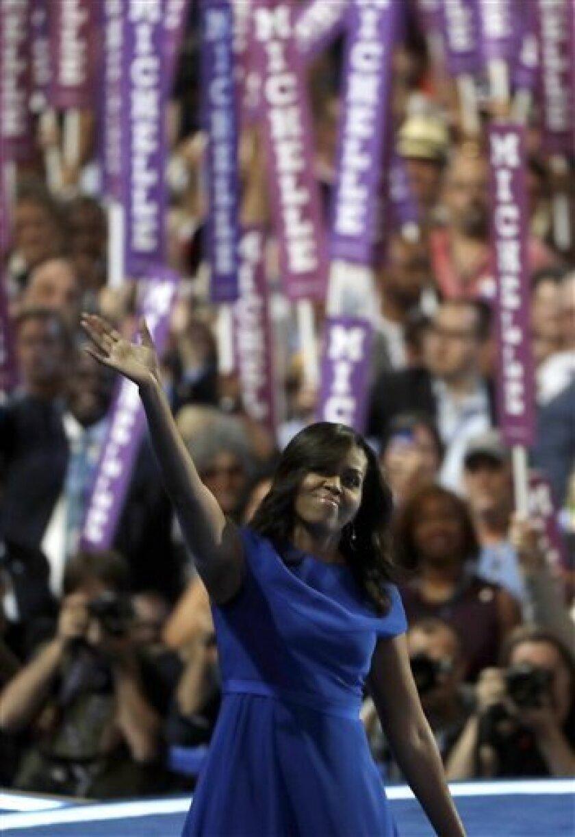 La primera dama de Estados Unidos, Michelle Obama, habla a los delegados durante el primer día de la Convención Nacional Demócrata en Filadelfia, el lunes 25 de julio de 2016. (AP Foto/Matt Rourke)