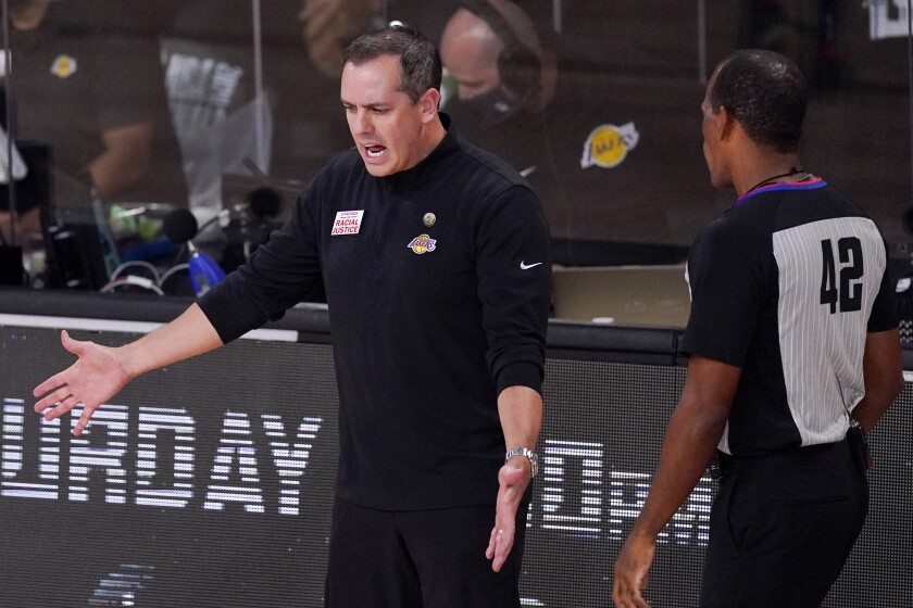 Lakers coach Frank Vogel argues with referee Eric Lewis during Game 5 of the NBA Finals.