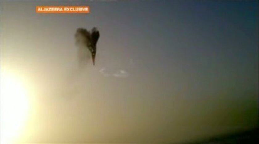 In this image taken from amateur video provided by Al-Jazeera, a hot air balloon over Luxor, Egypt bursts before plummeting about 1,000 feet to earth on Tuesday, Feb. 26, 2013. Nineteen people were killed in what appeared to be the deadliest hot air ballooning accident on record. A British tourist