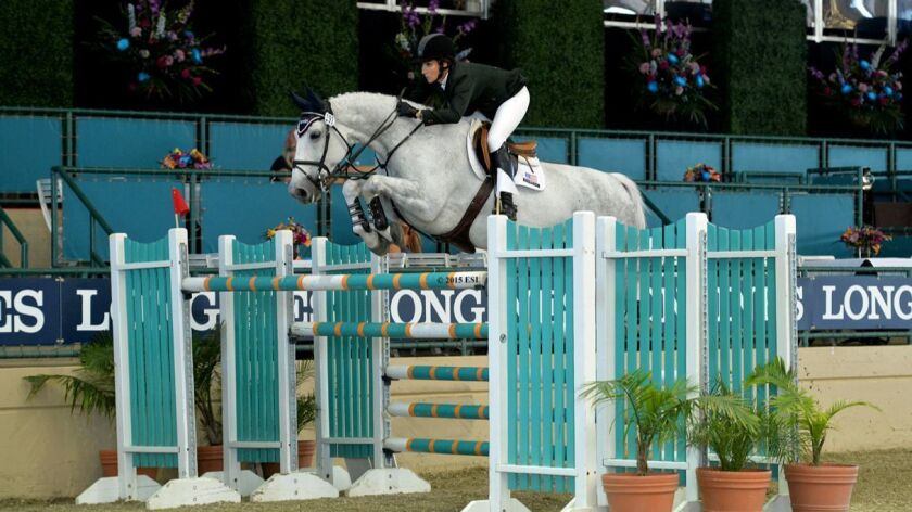 Mandy Porter, an Encinitas resident and world class show jumper, rides Eminent at Del Mar in a previous year. Porter expects to compete in this year's World Cup qualifying event as part of the Del Mar Horse Show in October.