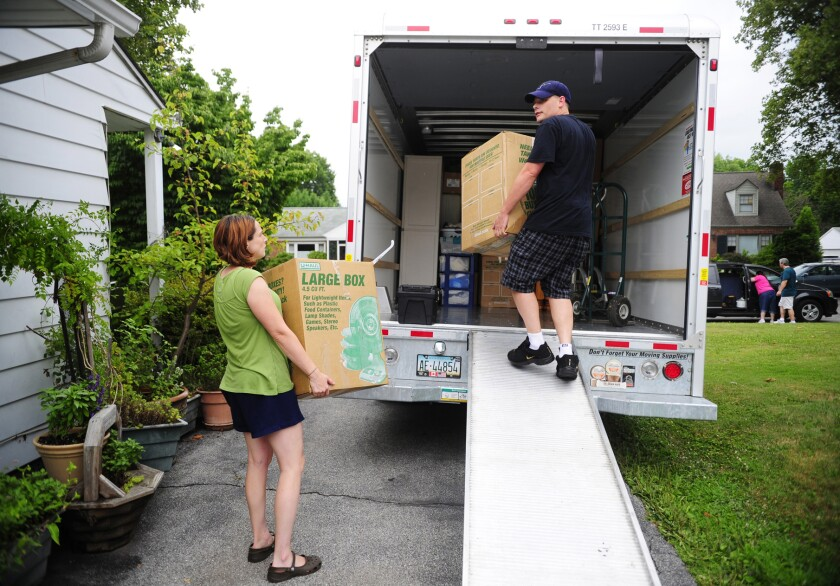 In this July 13, 2012, file photo, people load a U-Haul truck.