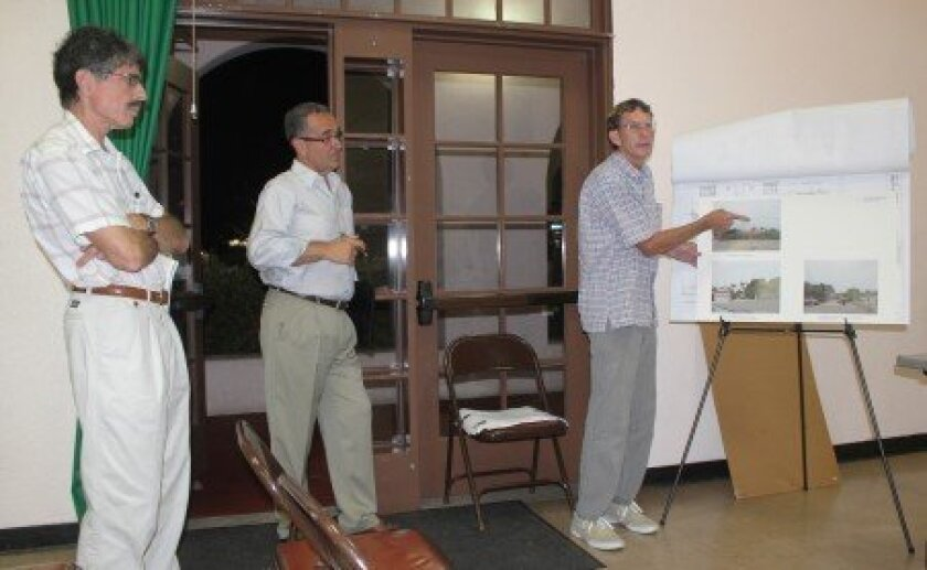 Architect Dan Linn (left) and Joe LaCava listen as Bonair Way resident Michael Sim shows photographs of himself using story poles to demonstrate how tall Linn's proposed residential development near his home would be. Sim was one of only two people at the LJCPA meeting to oppose the project.