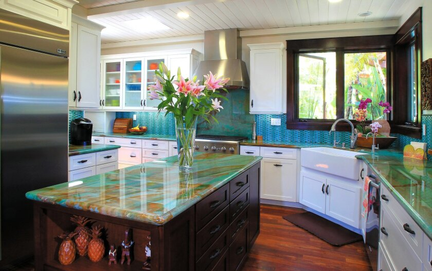 The color scheme for the expansive kitchen continues the tropical theme used throughout the home.