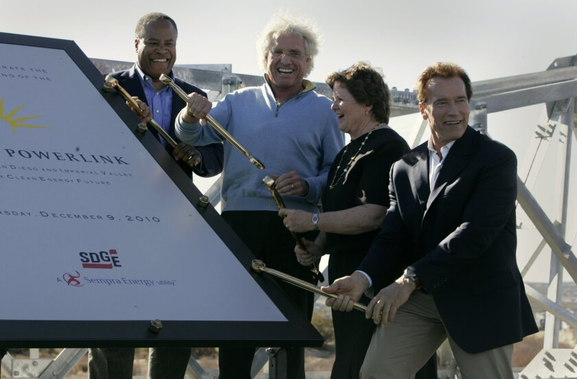 Jessie Knight, Jr., from SDG&E, left, businessman Joe Kennedy, Chula Vista Mayor Cheryl Cox and Gov. Arnold Schwarzenegger celebrate the groundbreaking ceremony in December 2010 for the first tower for the Sunrise Powerlink.