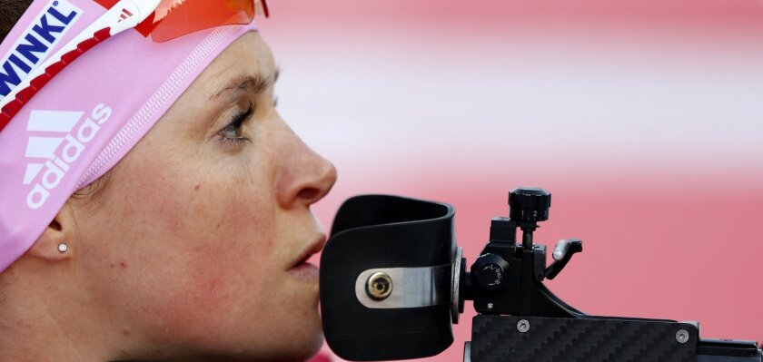 Germany's Evi Sachenbacher-Stehle prepares for shooting prior to the women's 4x6 km relay at the Biathlon World Cup in Ruhpolding, Germany, Wednesday, Jan, 8, 2014. (AP Photo/Matthias Schrader)