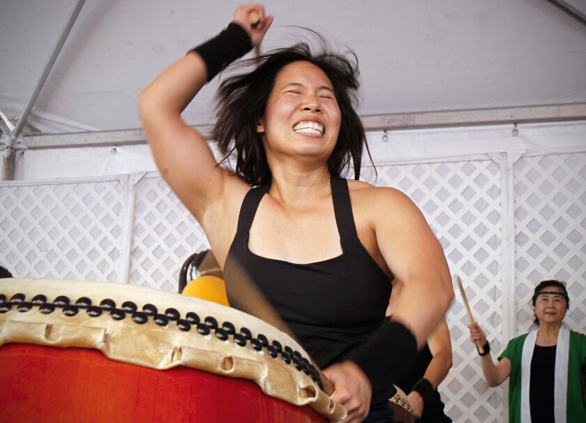 Diana Wu of the group, Naruwan Taiko drum ensemble performs during the Chinese New Year Food and Cultural Fair in the Gaslamp Quarter.
