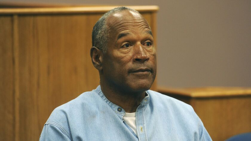 Former NFL football star O.J. Simpson appears via video for his parole hearing at the Lovelock Corre