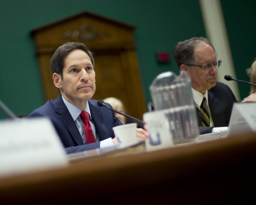 """CDC Director Dr. Thomas Frieden, left, appears before a hearing of the House Energy and Commerce Committee. Frieden called recent safety lapses dealing with deadly pathogens """"completely unacceptable"""" and vowed to make changes."""