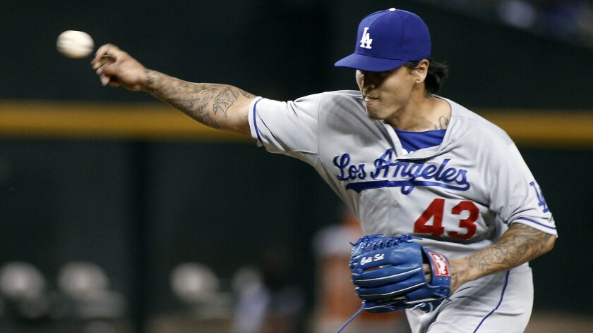 Dodgers reliever Brandon League delivers a pitch during a game against the Arizona Diamondbacks earlier this month.
