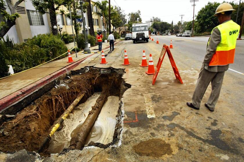 Michael Miller of the Los Angeles Department of Water and Power views a break in an 82-year-old water main in Hollywood. An assessment by the U.S. Environmental Protection Agency says California and other states sorely need repairing and upgrading of water transmission and distribution lines.