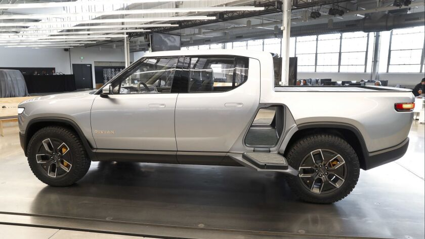 """A gear hatch behind the R1T cab can fit golf bags or snowboards, and provides a step to reach the roof. With powertrain batteries beneath the trunk and no engine under the hood, a front trunk, or """"frunk,"""" offers more cargo space, for a vehicle total of 11.6 cubic ft"""