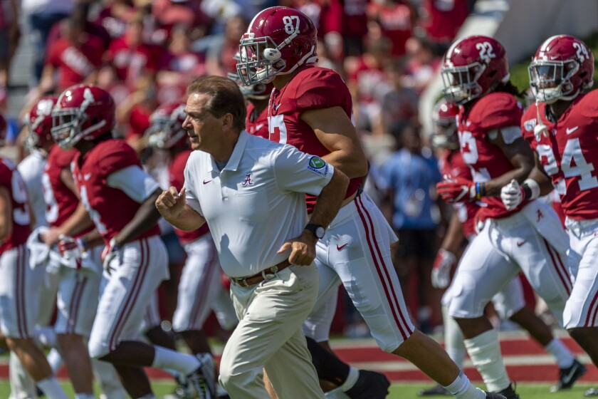 Alabama coach Nick Saban leads the team onto the field before a game against Mississippi.