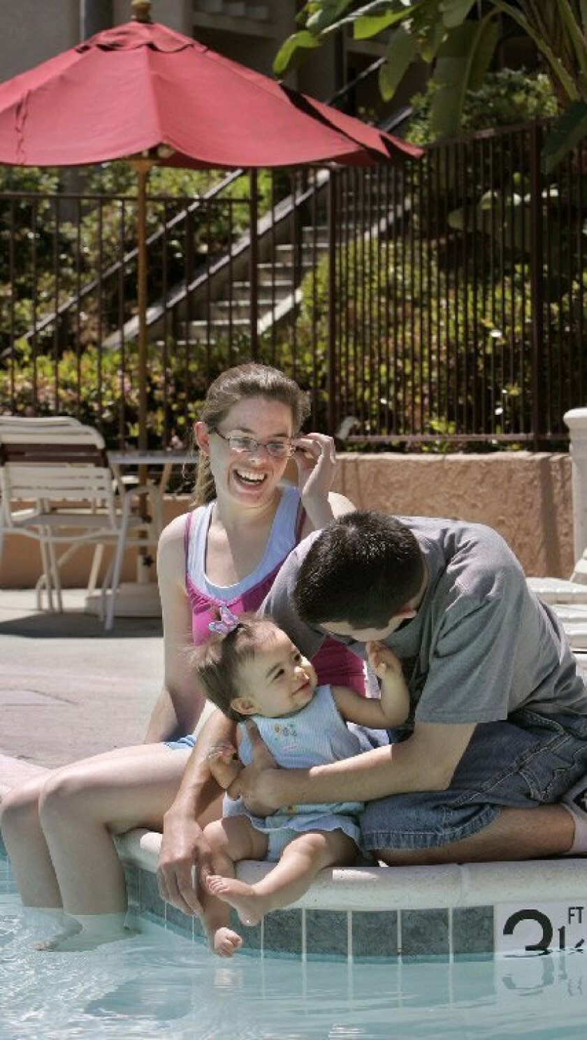 Leah and Moe Santini played with daughter Khalina, 1, at the 