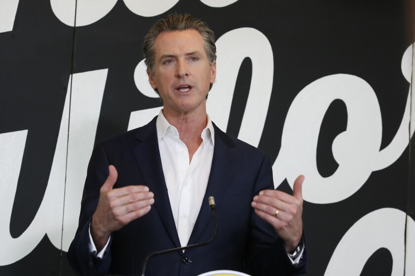 Gov. Gavin Newsom discusses his plan for the gradual reopening of California businesses during a news conference in Sacramento earlier this week.