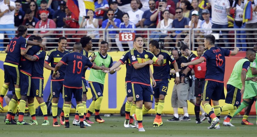 Colombia's players celebrate their team's first goal in a Copa America Centenario Group A soccer match against the U.S., at Levi's Stadium in Santa Clara, Calif., Friday, June 3, 2016. (AP Photo/Marcio Jose Sanchez)