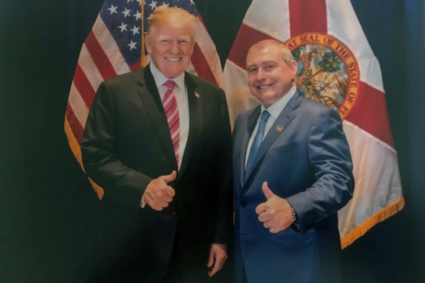 An undated photo of Lev Parnas with President Trump in Florida.