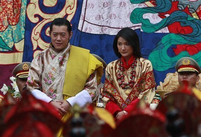 King Jigme Khesar Namgyal Wangchuck,left, and Queen Jetsun Pema sit during Buddhist blessings prior to their marriage at the Punakha Dzong, in Punakha, Bhutan, Thursday, Oct. 13, 2011. The 31-year-old reformist monarch of the small Himalayan Kingdom wed his commoner bride in a series ceremonies Thursday. (AP Photo/Kevin Frayer)
