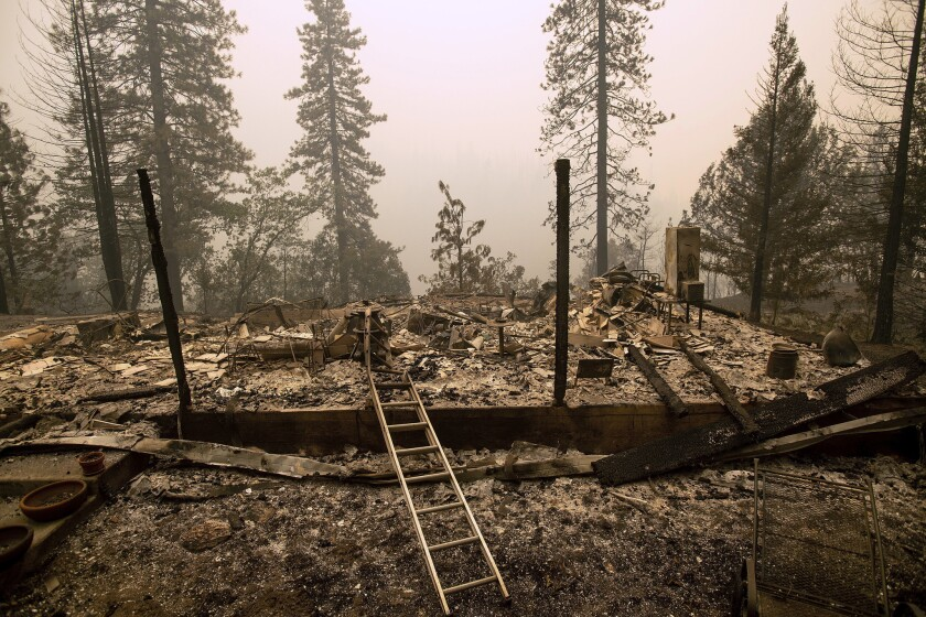 A home leveled by the Delta Fire rests in a clearing in Pollard Flat area of the Shasta-Trinity National Forest.